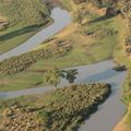An aerial image showing a river running through Gorongosa National Park, taken mid-flight during the Oxford-Gorongosa Paleo-Primate Field School 2018