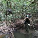 Dr Alex Mielke photographed collecting video footage of primates in the field