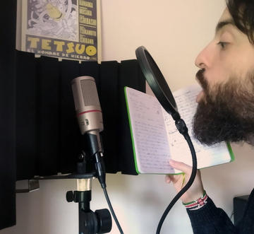 João recording a song in his home studio